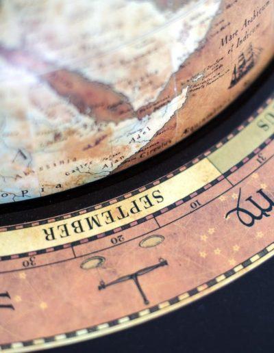 Da Vinci bar globe cabinet - rust color, product photo, zodiac ring