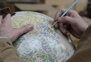 Image of Zoffoli craftsman hand painting globe map
