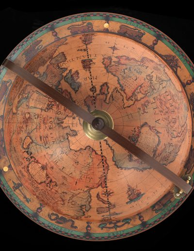 Studio photo of the classic color 16th century map replica by Zoffoli as featured on the Customer photo of the Roll-Out Calipso Large Globe Liquor Cabinet
