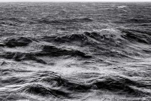 Black and white studio photo of the ocean for the product page of the 4-Legged Nautical Table Globe