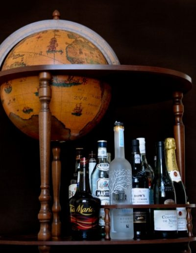 Studio photo of the Heroic Artemide Large Globe Bar Cart - closed, side