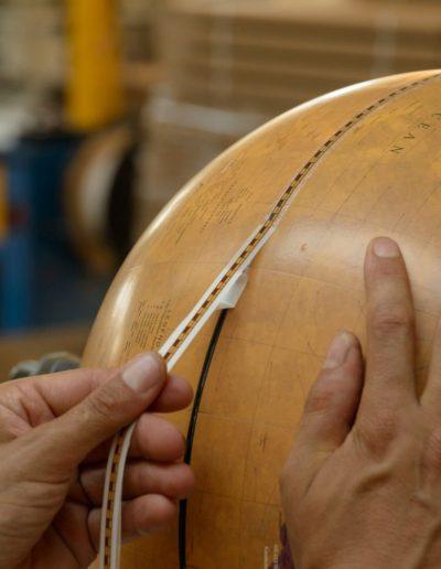 Studio photo of a Gea globe production process
