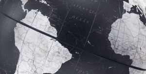 Studio photo of the updated political black map on the Floating Vela Small Black Globe