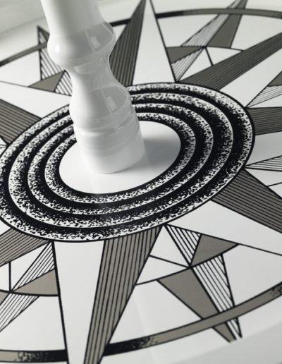 Studio photo of Vasco da Gama white world globe on a white stand - base closeup
