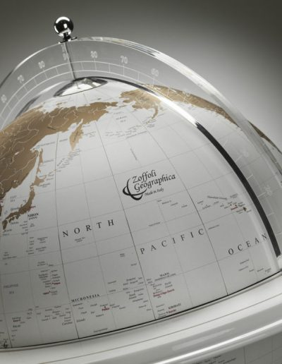 Studio photo of Vasco da Gama white world globe on a white stand 1